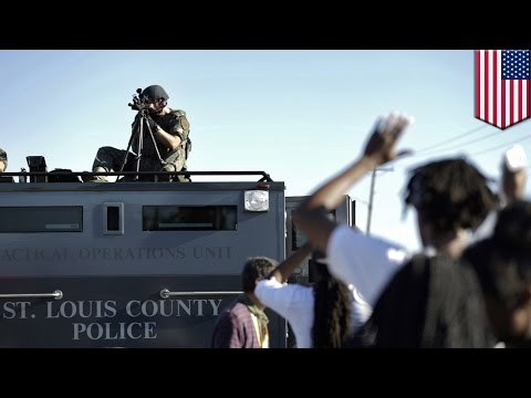 Michael Brown shooting: Police use teargas, flashbangs against protesters in Ferguson, Missouri