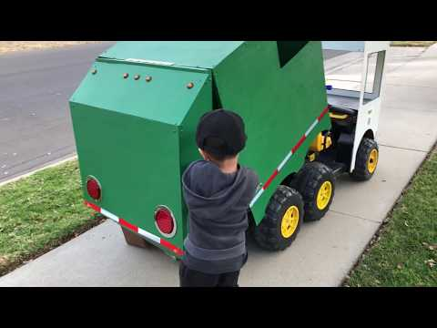 "Aidan ""The Garbage Truck Kid"" with Dump Action Garbage Truck  