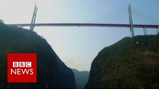 World's highest bridge opens in China - BBC News