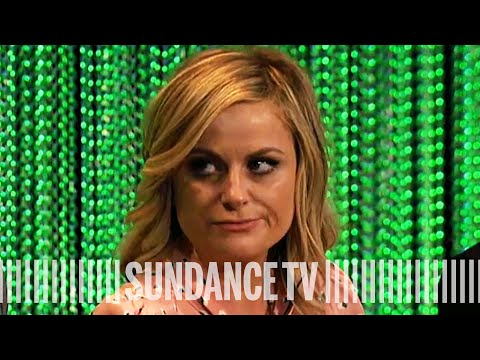 Parks & Recreation | Amy Poehler Talks Office Rivalry | BEHIND THE STORY