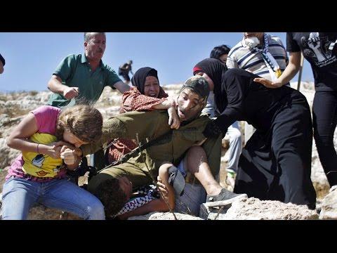 Palestinian women, teenage girl bite, fight off IDF soldier trying to arrest 12-yo boy