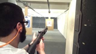 Tim Pio shooting Mossberg 590
