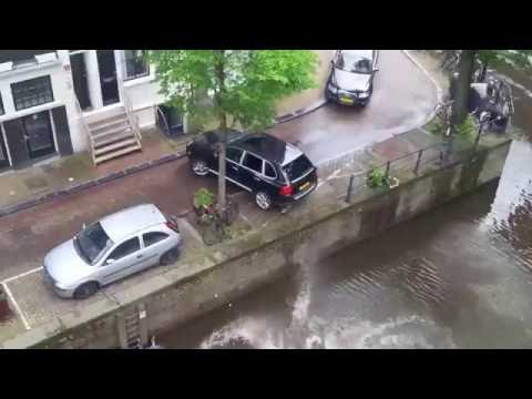Porsche pushes Smart into canal
