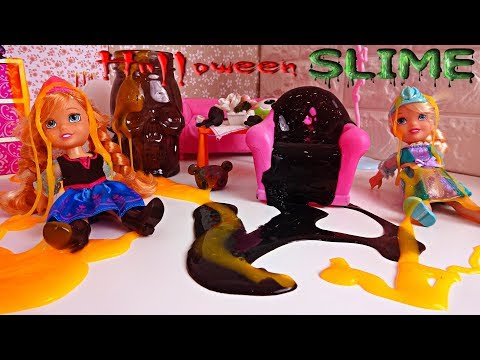 Elsa and Anna toddlers play with Halloween slime