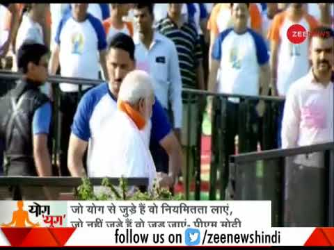 PM Modi performs asanas with volunteers during World Yoga Day In Dehradun