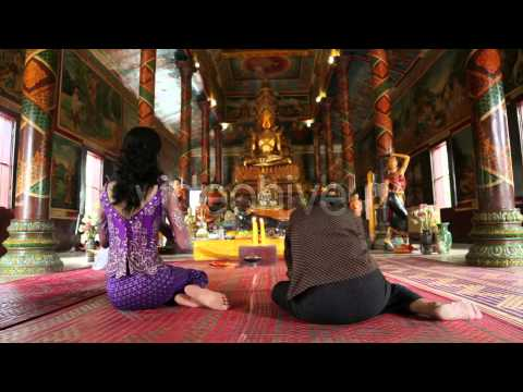 Stock Footage - Asian Girl Praying In Temple - Cambodia 6 | VideoHive