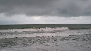 Scott riding the waves at Lido Key