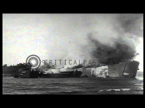US troops hose down deck of USS LST-340 to put off fire after being attacked by J...HD Stock Footage