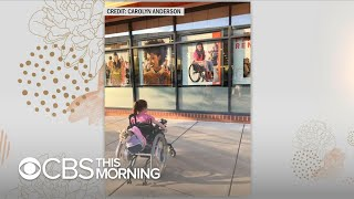 4-year-old in wheelchair in awe of Ulta model who is also in a wheelchair