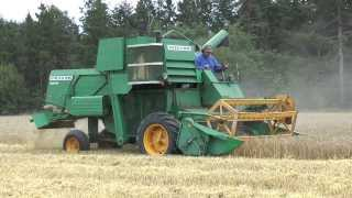 Harvests 2013 of barley with a Volvo BM 800 Active