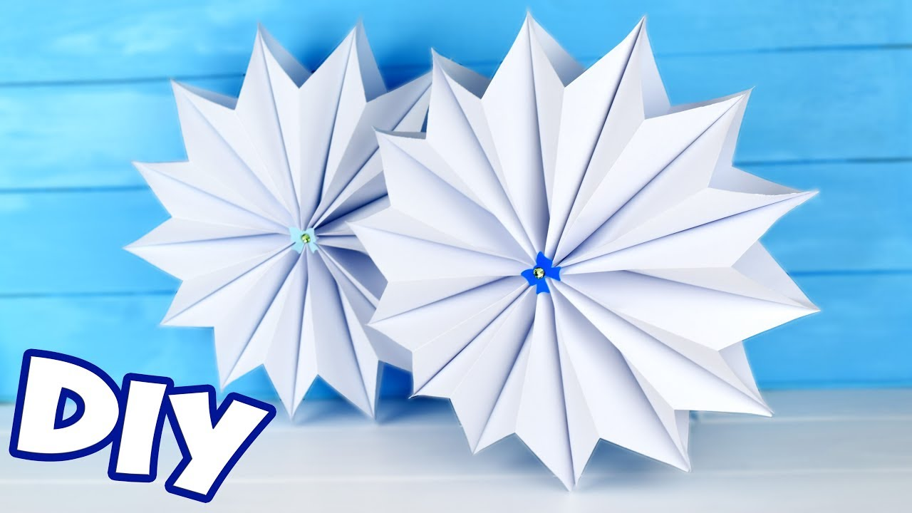 Как сделать 3д снежинку из бумаги своими руками видео