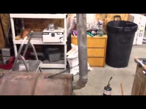 Gravity fed wood pellet barrel stove