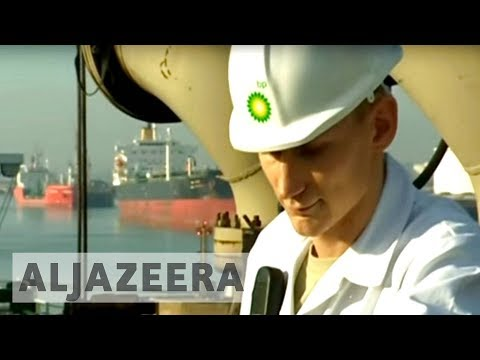 Global oil giants ExxonMobil and BP report losses