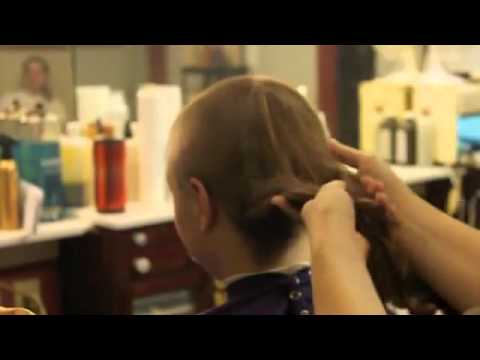 Buzz cut for a woman in barbershop