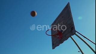 A Basketball Ball Flies Into the Basket. | Stock Footage - Videohive