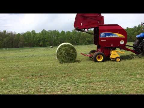 New Holland BR7060 Crop Cutter Round Baler powered by T6.155 Tractor 2013 NC Hay Day