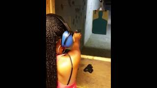 My cousin 's first time shooting a gun
