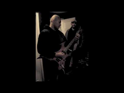 Doc Coyle of God Forbid playing guitar at Metal Rules! Radio while Stink Fisher looks on