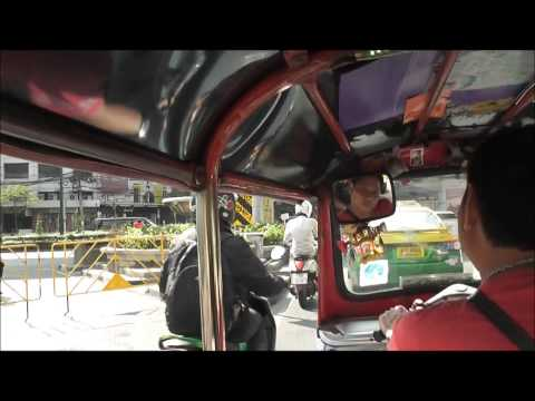 driving with a tuk tuk in Bangkok during protest time