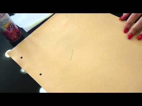 Как стереть с дивана из кожи ручку