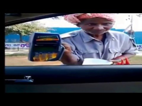 Hi - Tech  beggar with ATM card swipe machine! Hyderabad, India.