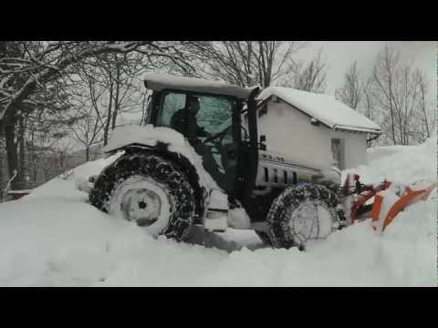 Lamborghini tractor plowing snow and stuck in it