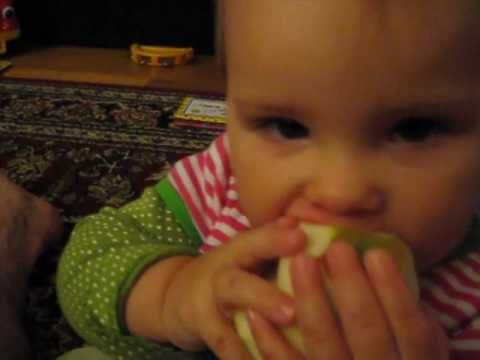 Baby's Arm Holding an Apple