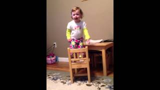 Baby falls off chair while watching barney