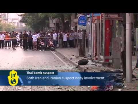 Thai Police Escort Iranian Suspect Mohammad Harzei to sites used in the Bangkok Bomb Attacks
