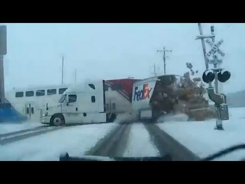 Dramatic crash between truck, train caught on camera