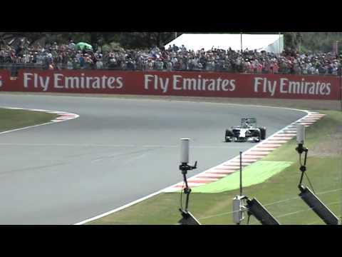 F1 British Grand Prix 2014 Hamilton celebrates the win and Jenson Button at Woodcote 06.07.14