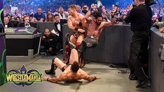Finn Bálor drives Seth Rollins and Miz into the ringside barricade: WrestleMania 34 (WWE Network)