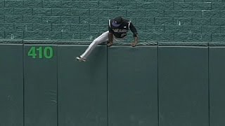 Fowler loses glove, hops fence to retrieve it