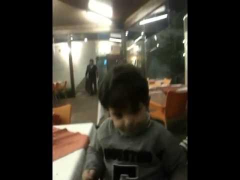 Little boy cheering: Allah Syria Bashar w bas