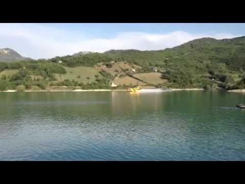 Italian firefighter plane scoops up water