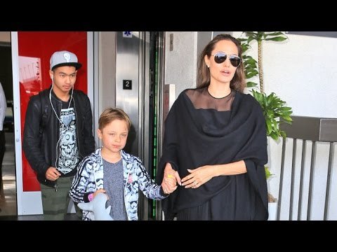 Angelina Jolie Elegant In Black With Sons Knox And Maddox And Brother James At LAX