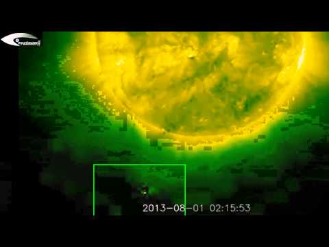 High activity of UFOs in the coronal hole on the Sun and Giant UFOs near the Sun - August 1, 2013