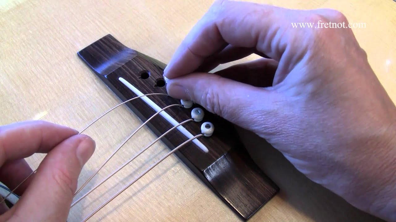 changing guitar strings what causes flying bridge pins