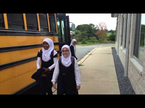 Al Huda School girls leaving the bus and entering future Al Huda School in shaa Allah