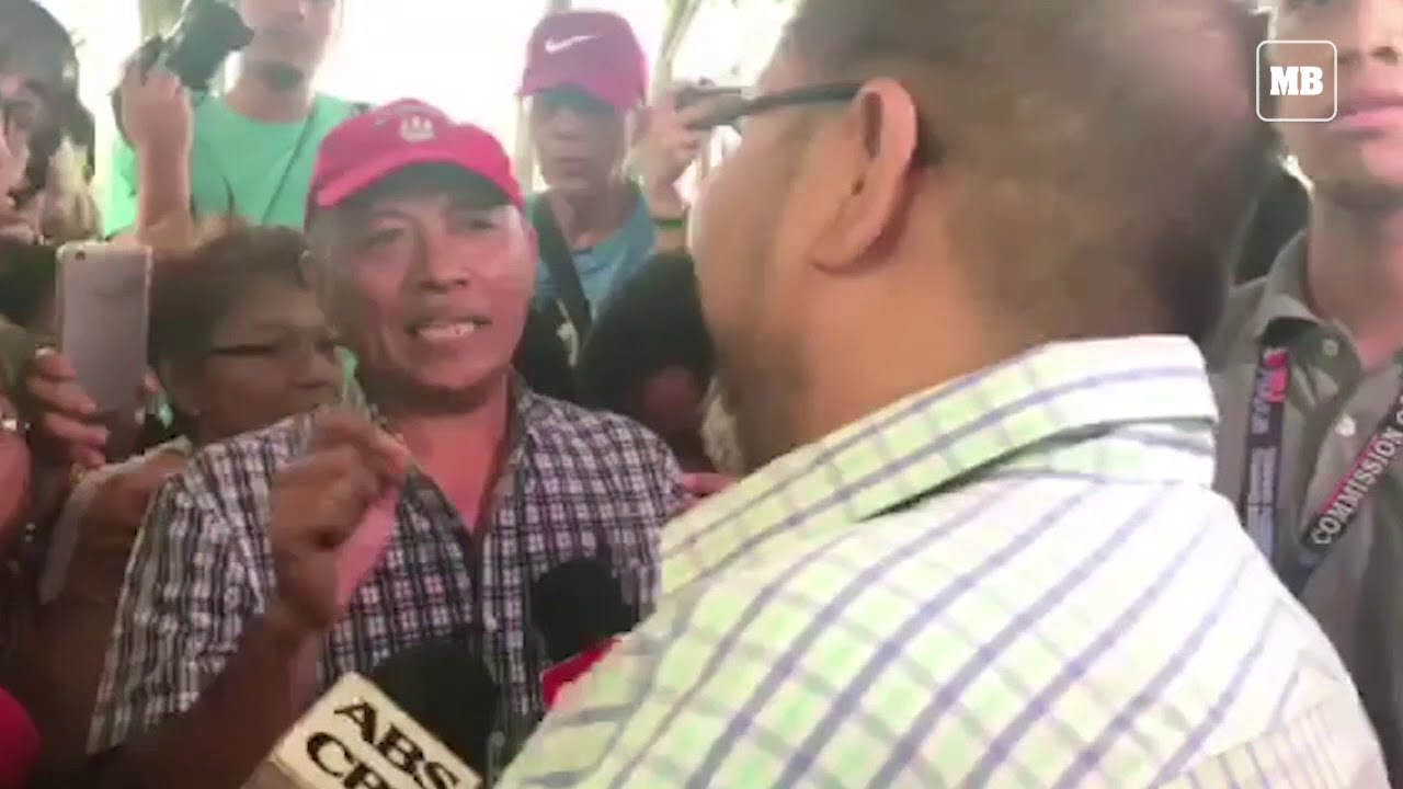 COMELEC spokesman James Jimenez talks to the anti-smartmatic rallyists