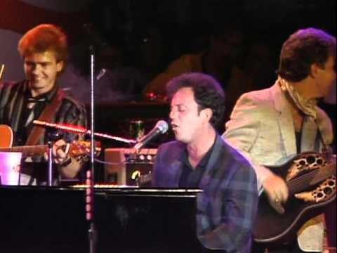 Thumbnail of video Billy Joel - Only The Good Die Young (Live at Farm Aid 1985)
