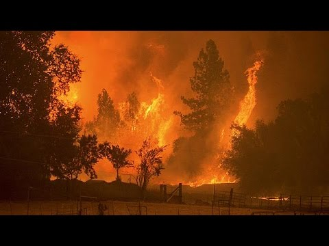 California wildfires force thousands to flee homes