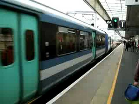 Here is a Class 317 double-set departing Cambridge for London Liverpool Street operated by National Express East Anglia (NXEA) still in the former, but modif...