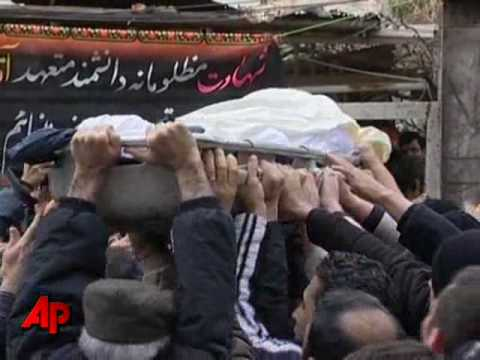 Iranian Mourners, Opposition Bury Slain Physicist