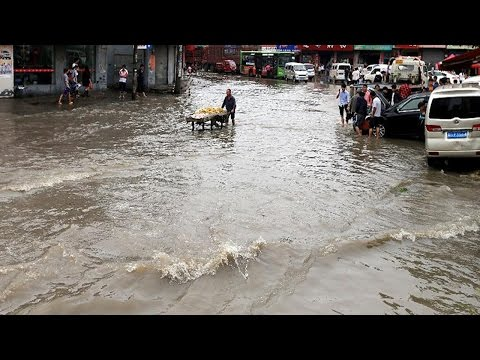 shanghai storm nearly sinks the whole city cracking down the manucipal traffic drainage system
