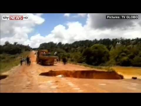 Drama As Bus Sinks Into Crater