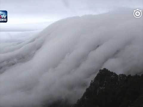 Incredible moment cloud flows down the top of the Lu Mountain like a waterfall