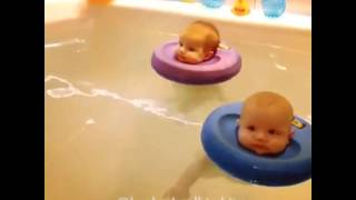 Babies floating in water