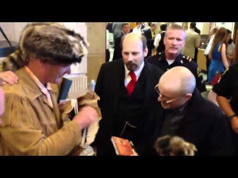 Phil Collins Kissing Hand of Admirer, Meeting People at Dallas Historical Society Event