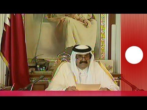 Qatar's Emir hands power to 33-year-old son